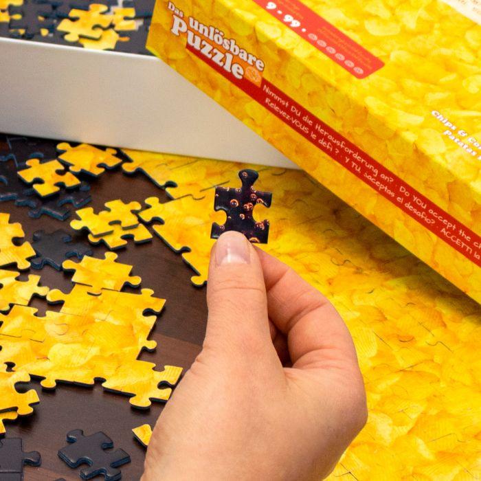 Das unlösbare Puzzle - Chips und Cola