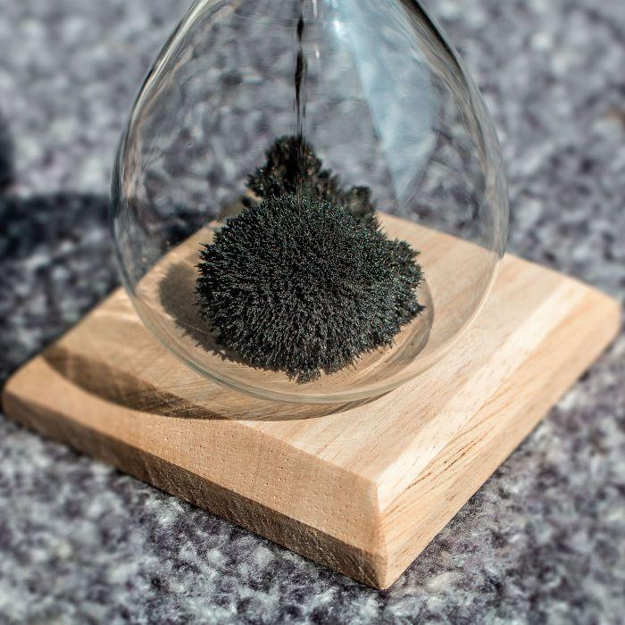 Magische Sanduhr mit Holz Sockel