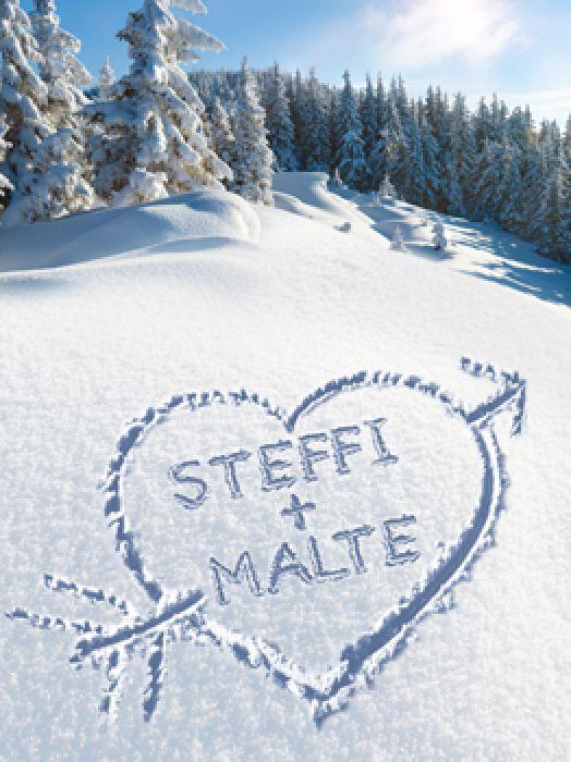 Cœur dans la neige – tableau en cadre blanc